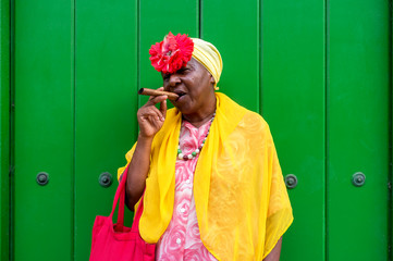 Aluminium Prints Havana Old Cuban lady smoking a large cigar in La Havana, Cuba