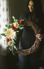 Woman holding wreath