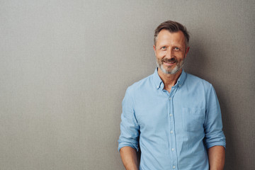 Relaxed attractive smiling middle-aged man