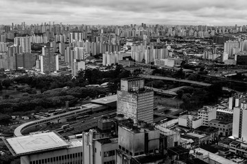 Grayscale photography of city with high-rise buildings