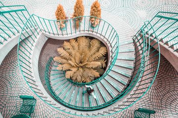 Overhead view of person walking on spiral stair