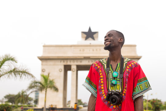 Man visiting the independence arch in Accra, Ghana