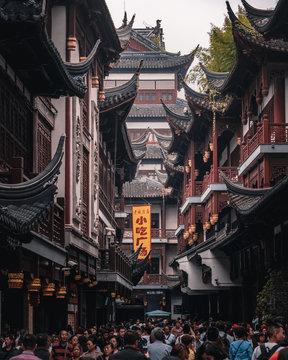 People walking on street between temples
