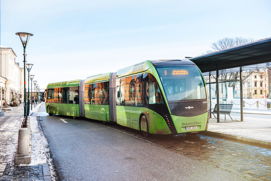 MALMO, SWEDEN - 29 DEC 2014: Modern double articulated bus Van Hool 324H Exequicity 24 Hybrid operated by Skanetrafiken arriving in bus station on a cold winter day - ecologic public line 5 in Malmo
