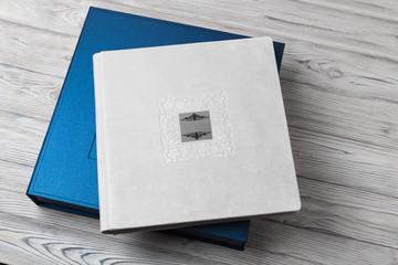 blue stylish square cardboard box for a photo album. Bright original box for white wedding album. leather photo book in the open box blue cardboard box for a photo book Wall mural