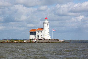 Poster Horses Traditional lighthouse 'Het Paard van Marken' in Marken the Netherlands