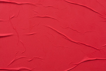 Red crumpled sheet of paper close-up.