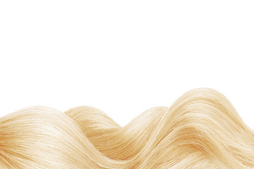 Natural blond hair isolated on white. Background, copy space Fototapete