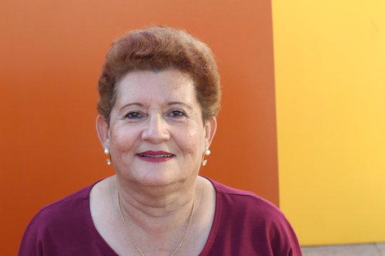 One Hispanic senior woman smiling