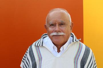 Senior Hispanic man with traditional clothing