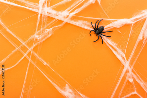 Halloween background with spider web and spiders as symbols of Halloween on the orange background. Happy Halloween concept. Frame.