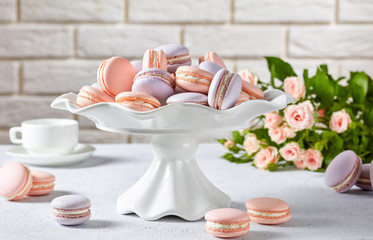 french pink and lavender macarons on a cake stand