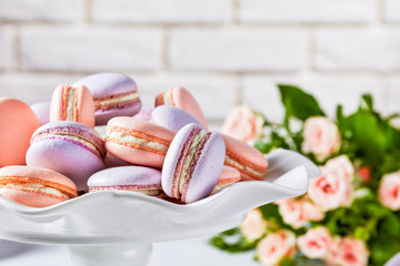 close-up of macarons on a white platter