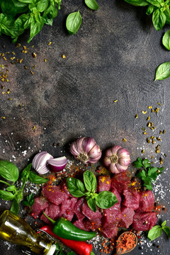 Raw meat with ingredients for making stew or ragout. Top view with copy space.