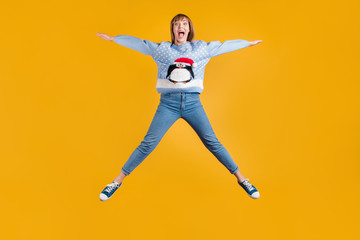 Omg I can fly. Full body photo of pretty funky comic joking screaming enjoying life having good mood hipster student stretching legs and arm to the sides in star shape isolated vivid color background