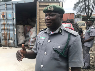 A customs official talks about the seizures of containers with sacks of confiscated pangolin scales, close to Nigeria Customs Service in Ikeja
