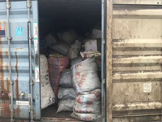 A container with sacks of confiscated pangolin scales is seen close to Nigeria Customs Service in Ikeja