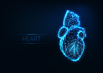 Futuristic glowing low polygonal human heart isolated on dark blue background.