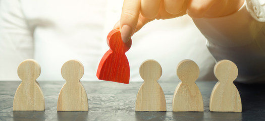 Businesswoman dismisses the employee from the team. Personnel Management. Bad worker. Demotion. The concept of finding people and workers on the job. Selection of teams, the appointment of a leader.