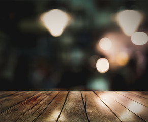 3D Rendering, Empty wooden table top with colorful lights bokeh on blur restaurant background,night bokeh