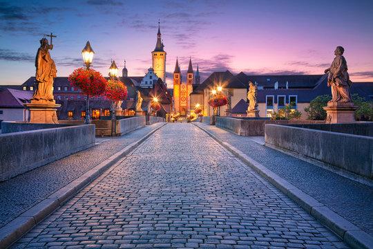 Wurzburg, Old Main Bridge. Cityscape image of the old town of Wurzburg with Old Main Bridge over Main river during beautiful sunrise.