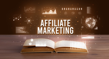 AFFILIATE MARKETING inscription coming out from an open book, creative business concept