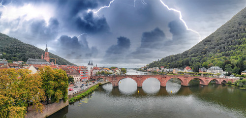 Heidelberg skyline aerial view from drone, Chain Bridge and city skyline with storm approaching on background
