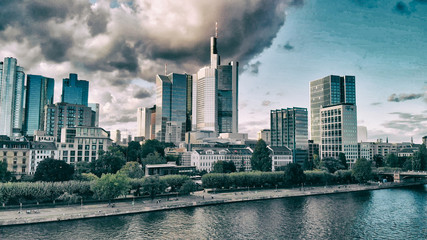 Aerial flying along the futuristic skyline the business and financial centre of Frankfurt am Main, sunset view from drone