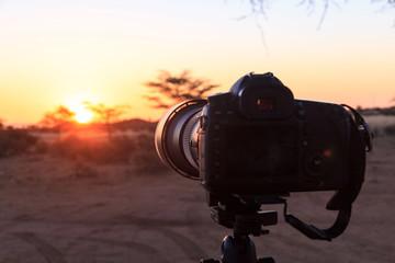 Camera on tripod, sunset light, Namibia