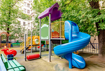 Modern playground in the courtyard of a residential building