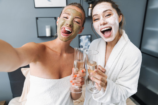 Women taking care of their skin take selfie by camera.