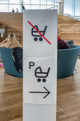 Baby carriage parking sign in a public library