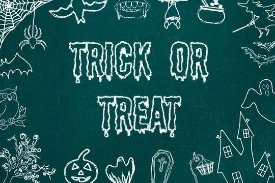 Trick or Treat chalkboard background. Halloween symbols