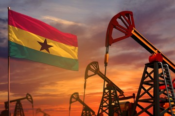Ghana oil industry concept. Industrial illustration - Ghana flag and oil wells with the red and blue sunset or sunrise sky background - 3D illustration