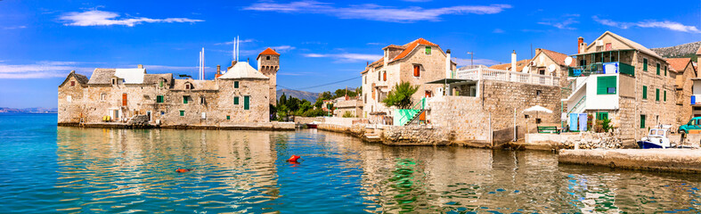 Landmarks of Croatia: Kastel Gomilica - old sea castle and traditional fishing village in Kastela, central Dalmatia