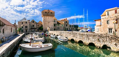 Travel and landmarks of Croatia. Kastel Gomilica - old castle over the sea, popular tourist attraction near Split. Damatia Wall mural