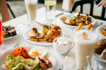 Breakfast Buffet Concept, Breakfast Time in Luxury Hotel, Brunch with Family in Restaurant, Table with Plates of Food for Breakfast - Image