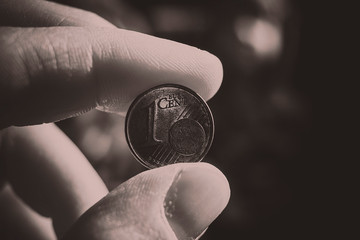 1 euro cent between fingers
