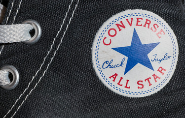 AACHEN, GERMANY OCTOBER, 2017: Converse All star logo printed on the side of the shoe. Founded in 1908 is an American lifestyle company with a production output of shoes and lifestyle fashion.