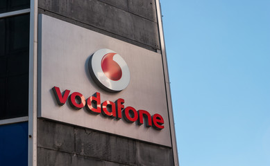 COLOGNE, GERMANY OCTOBER, 2017: Vodafone logo. Vodafone Group is a British telecommunications company headquartered in London and with its registered office in Newbury, Berkshire.