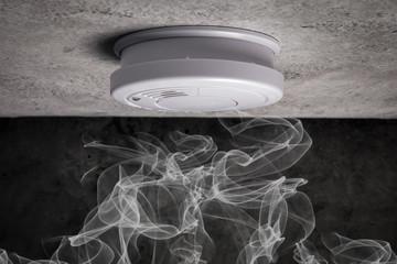 Close up smoke detector on a ceiling. Smoke, fire alarm