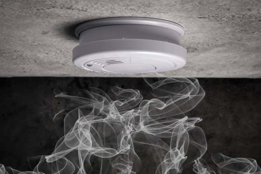 Close up smoke detector on a ceiling. Smoke, fire alarm