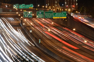 Downtown Atlanta highway with light trails during rush hour