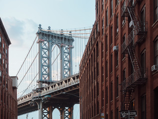 Acrylic Prints Narrow alley Manhattan bridge
