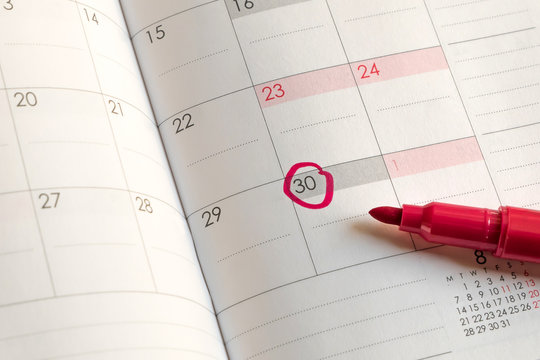 Mark on date circled on month calendar, Red circle on 30 with Red Magic Pen.