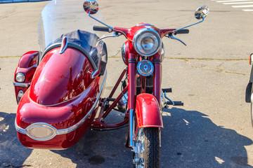 Retro tricar. Three-wheeled motorcycle on city street