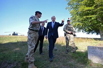 Britain's Prime Minister Boris Johnson and Britain's Defence Secretary Ben Wallace meet with military personnel on Salisbury plain training area near Salisbury