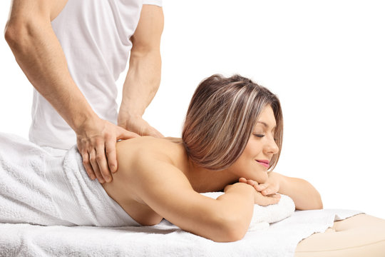 Relaxed young woman having a massage on her back