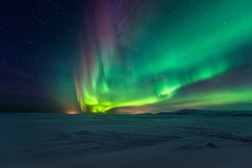 Northern lights aurora borealis in the winter