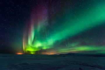 Foto op Plexiglas Noord Europa Northern lights aurora borealis in the winter